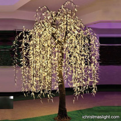 Warm white lighted weeping willow trees